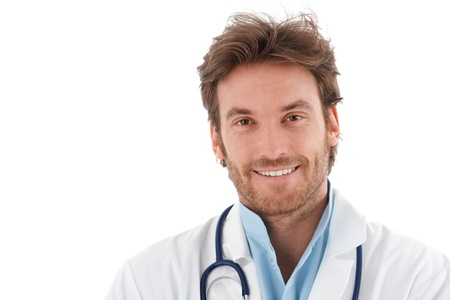 Portrait of confident handsome young doctor, smiling at camera. photo