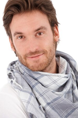 bristly: Closeup portrait of handsome young man, looking at camera, smiling.