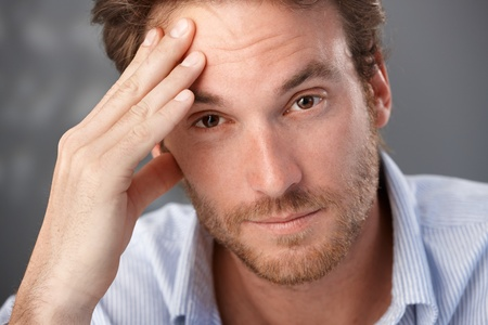 only adult: Closeup portrait of troubled man looking at camera, worried.