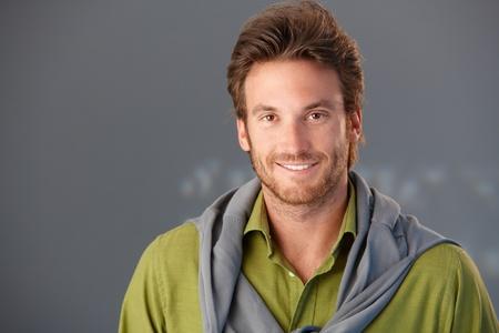 Closeup portrait of smiling goodlooking man, copyspace. photo