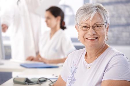 Senior woman at doctors room waiting for examination. photo