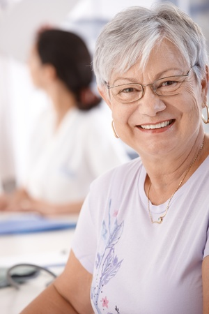 consultant physicians: Portrait of smiling senior woman, looking at camera.