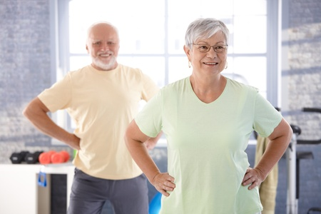 boomer: Vital pensioners exercising in the gym. Stock Photo
