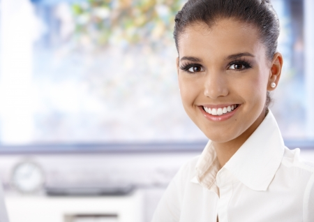 white teeth: Portrait of attractive young female, smiling, looking at camera.