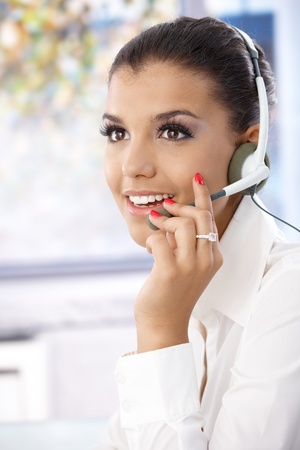 Portrait of attractive young female dispatcher working, smiling. photo