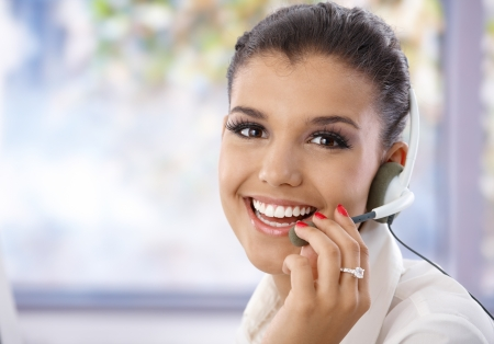 Portrait of pretty young dispatcher, smiling, looking at camera. photo