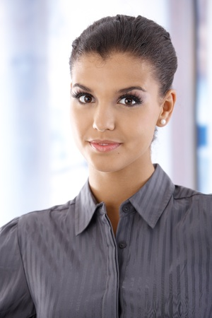 Portrait of attractive young woman, looking at camera. photo
