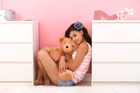 soft toy: Pretty girl hugging soft toy bear with love.