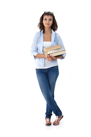 blouse: Pretty young student holding books.