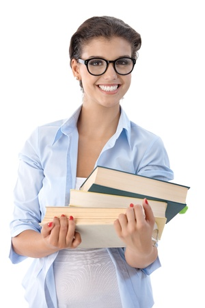 Attractive university student holding books in hand. photo