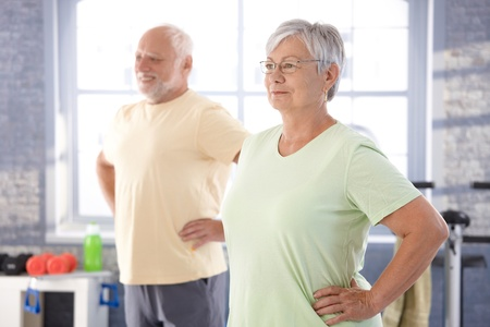 elderly exercise: Elderly people doing exercises in the gym.