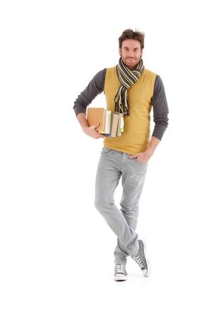 full size: University student smiling, holding books.