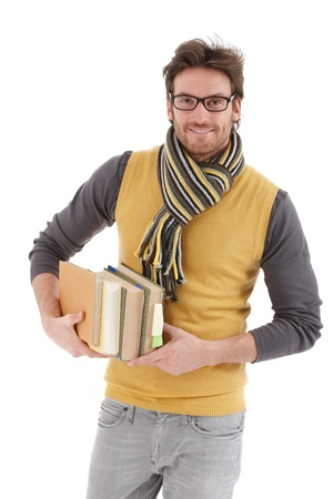 exercise book: Young handsome man holding books, smiling at camera.