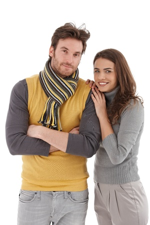 Attractive trendy couple hugging, smiling at camera. photo