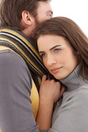 fantasize: Beautiful daydreaming woman hugging man, looking away.