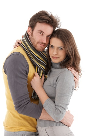 tenderly: Beautiful young loving couple embracing tenderly, smiling.