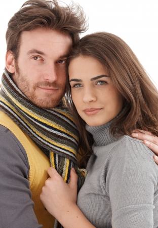 20s  closeup: Closeup photo of attractive young loving couple, smiling, looking away. Stock Photo