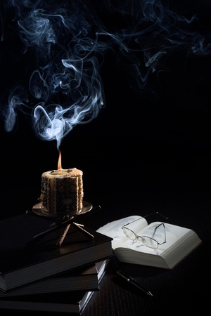 codex: Stille-life on a desk: an old candle, books and glasses