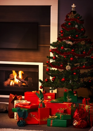 Still life photo of presents and christmas tree in living room. Stock Photo - 10494089