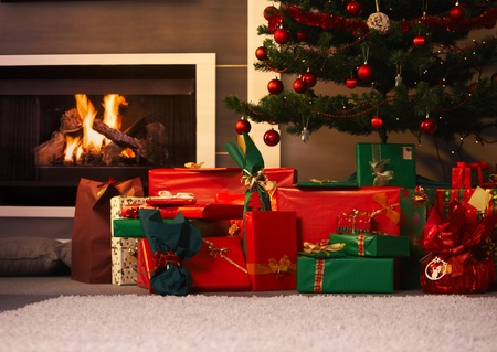 Still life photo of presents and christmas tree in living room.