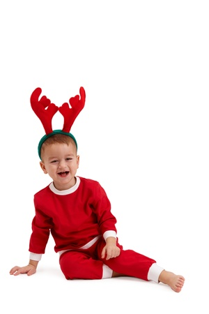 Portrait of happy little boy with reindeer hair band laughing at camera. Stock Photo - 10663507
