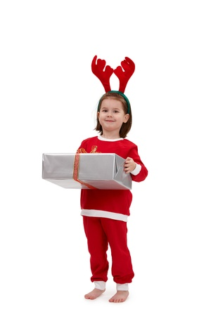 Cute kid in santa costume holding present.