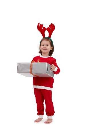 Cute kid in santa costume holding present. photo
