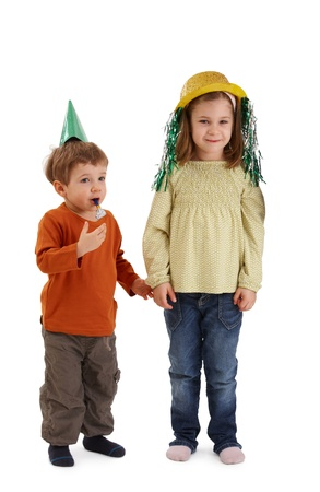 Children ready for birthday celebration, wearing party accessories. photo
