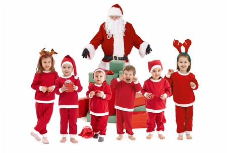 three presents: santa claus and happy little children preparing for christmas, children wearing santa costume.�
