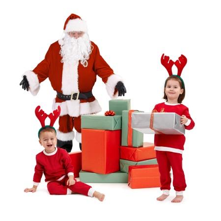 santa claus and happy little children preparing for christmas, children wearing santa costume.� photo
