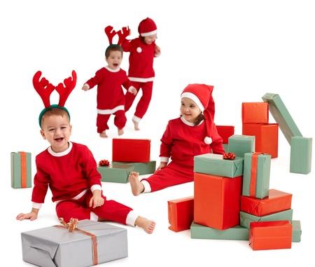 happy little children wearing santa costume preparing christmas presents.�