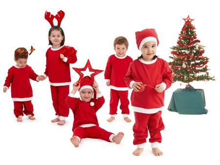 happy little children preparing for christmas wearing santa costume.� photo