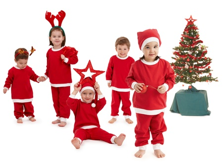 happy little children preparing for christmas wearing santa costume.� photo