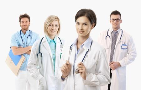 Team of smiling medical doctors on white background, portrait.