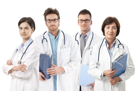 Group portrait of doctors on white background, looking at camera, smiling, photo