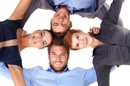 businessteam: Young smiling businessteam embracing, view from below. Stock Photo