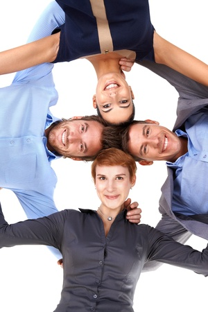 Smiling young businesspeople standing embracing, view from below. photo