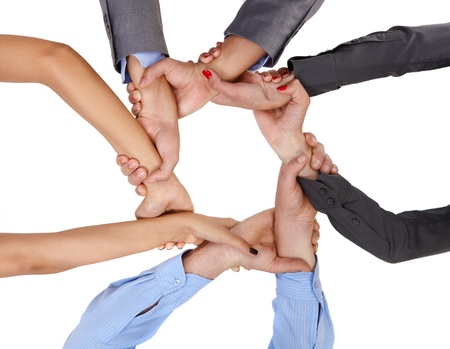 linking: Businesspeople linking arms demonstrating business union, viewed from below. Stock Photo
