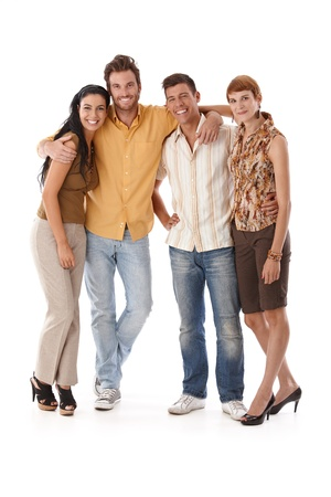 four people: Happy companionship standing embracing, smiling, looking at camera. Stock Photo