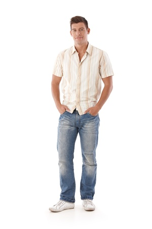 full size: Young man in jeans and shirt standing with hands in pocket.