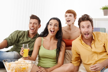 Young friends watching football at home, jittering. Stock Photo - 11157150