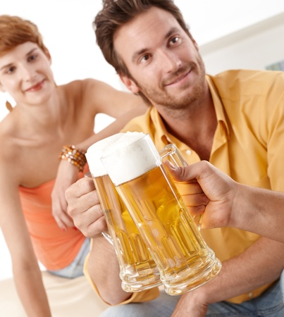 ginger hair: Clinking beer glasses, having party.