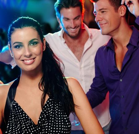 black man white woman: Beautiful young woman and friends having fun in nightclub.