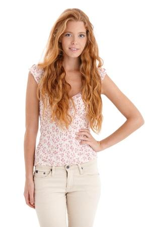 beautiful redhead: Beautiful long hair redhead woman smiling at camera. Stock Photo
