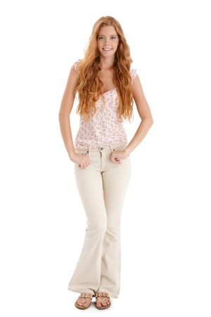red hair woman: Happy summer portrait of redhead girl with long curly hair, smiling at camera, cutout on white. Stock Photo