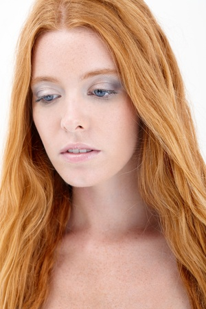 redhead: Portrait of natural redhead beauty looking sad. Stock Photo