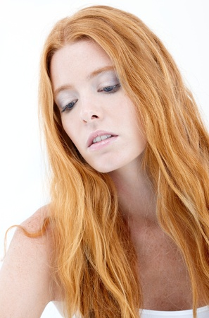 Facial portrait of troubled redhead, natural beauty with long red hair. photo