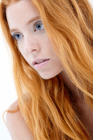 Closeup facial portrait of natural redhead beauty. photo