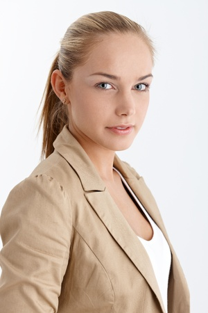 Smiling blonde girl portrait with ponytail, looking at camera, studio. photo