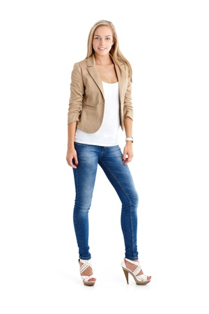 girl in jeans: Attractive blonde teenager in trendy jeans and high heels, full length studio portrait. Stock Photo